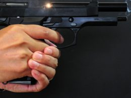 A close up shot of the Beretta M92 being held