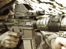 Reflex sight with laser designator
