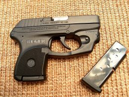 Ruger LCP with a laser and magazine