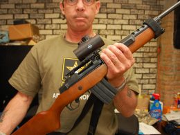 A man holding Ruger Mini 14