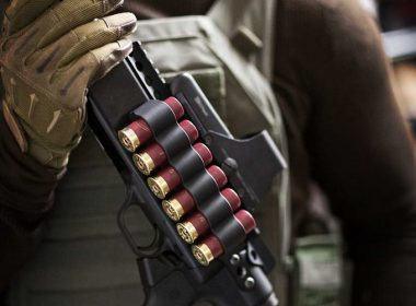A shotgun with side ammo carrier