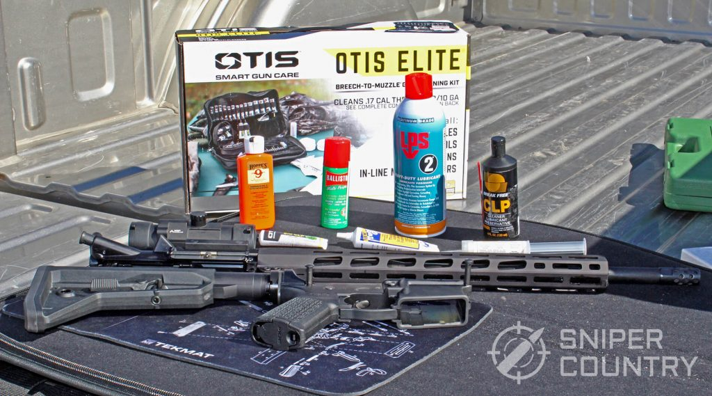 Gun oils and greases next to an AR-15