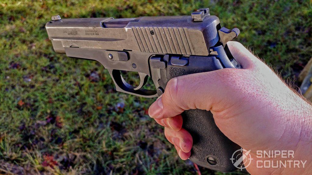 Sig Sauer P220 in hand