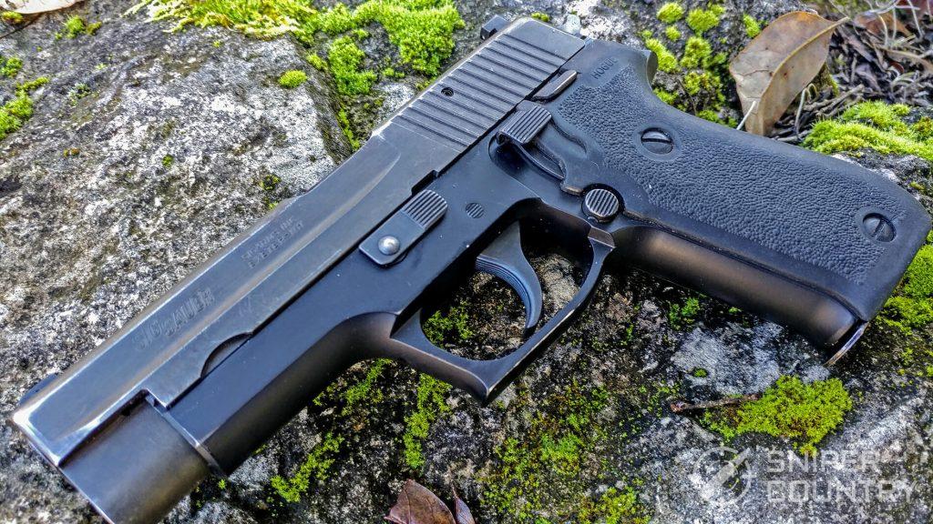 Sig Sauer P220 on rock