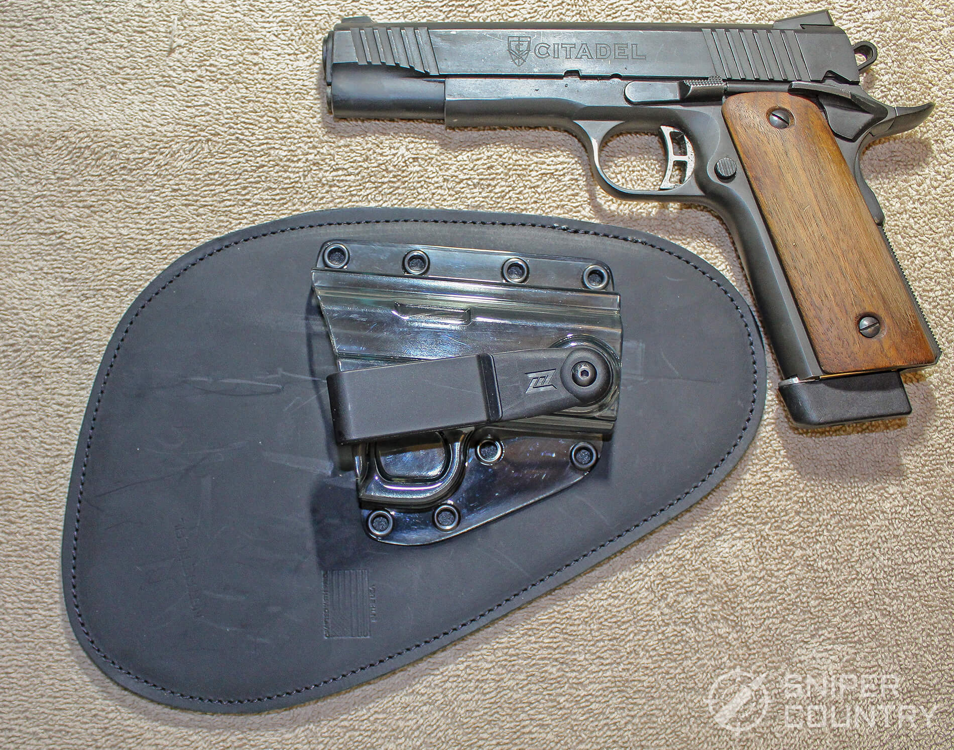 The 1911 next to professional holster