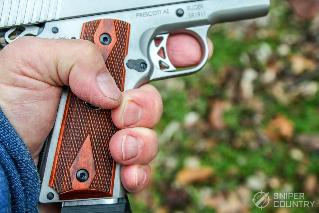hand on grip of Ruger SR1911 Commander