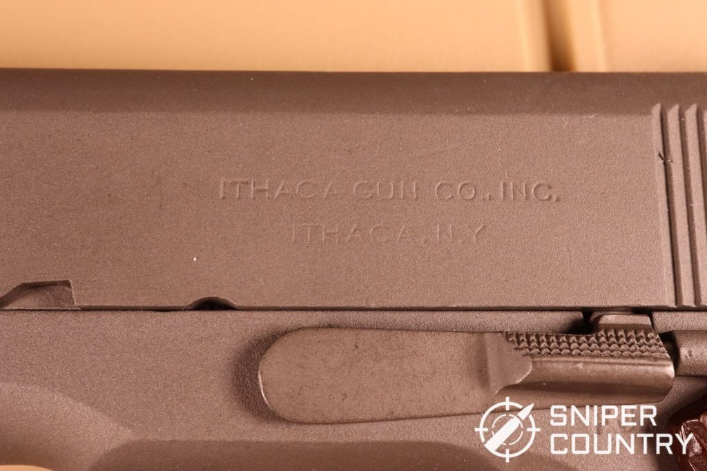 """The slide is marked """"ITHACA GUN COMPANY."""" It's not uncommon for armory reworks to have mismatched slides and frames. Originally established in 1880, the Ithaca Gun Company is still in operation today."""