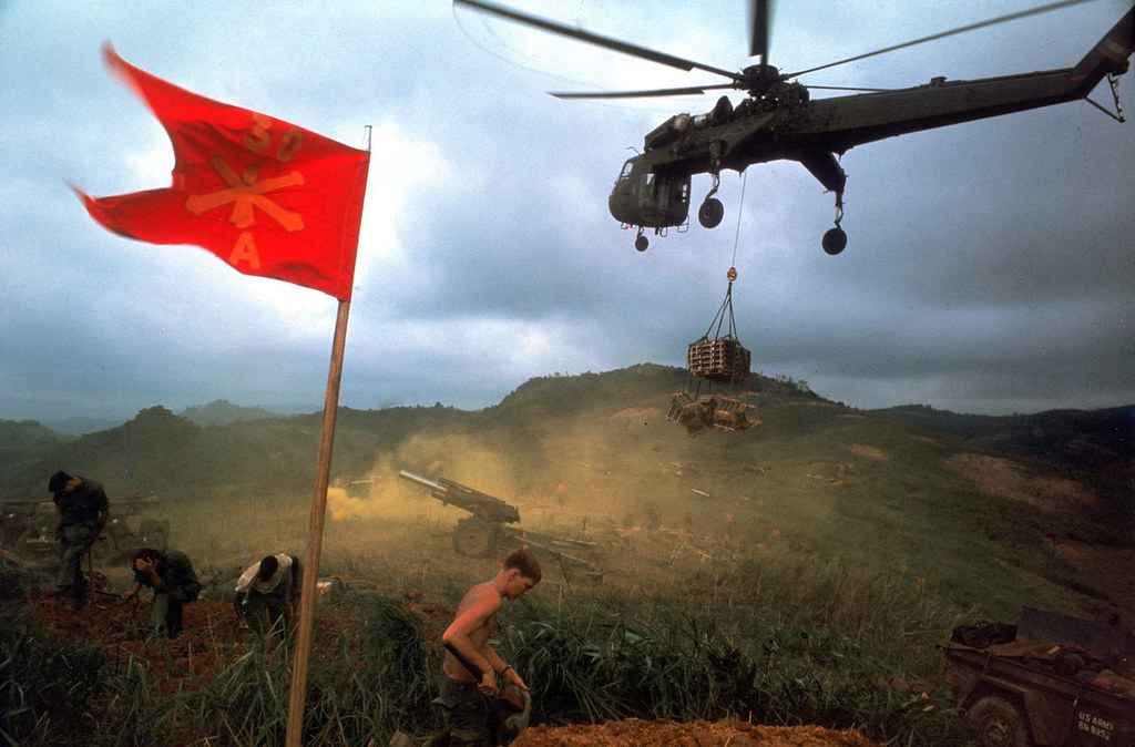 Vietnam War 1968 - An American 1st Air Cavalry helicopter airlifts supplies into a Marine outpost during Operation Pegasus