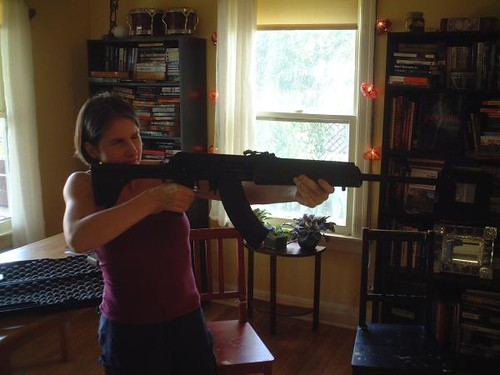 Best Gun for Home Defense Woman Holding Firearm