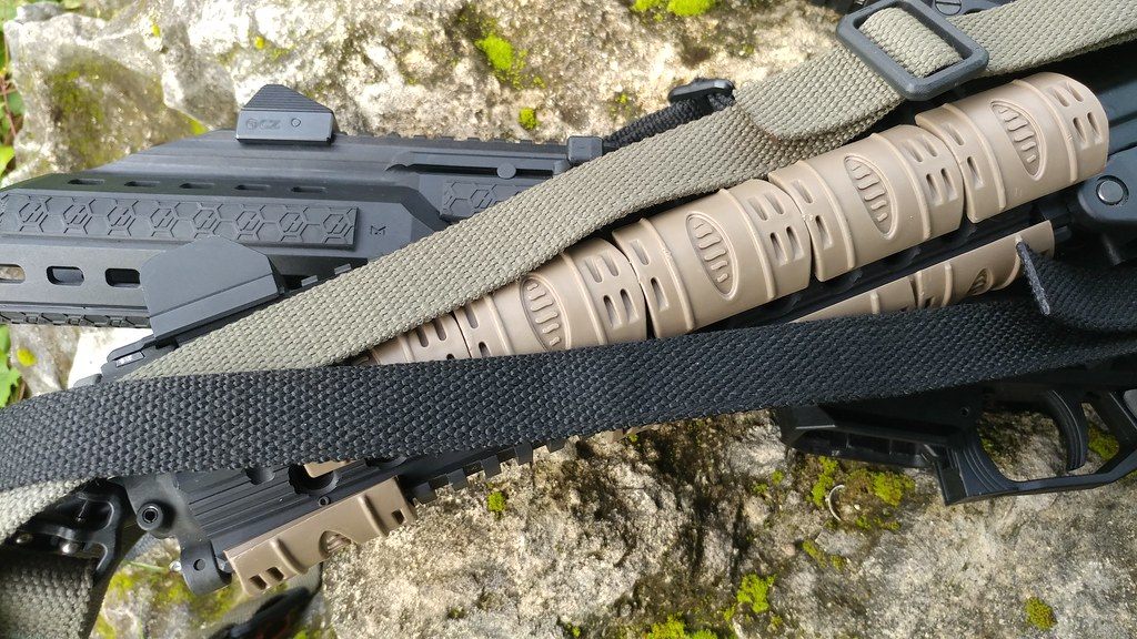 Best AR 15 Slings Different slings mounted to a gun