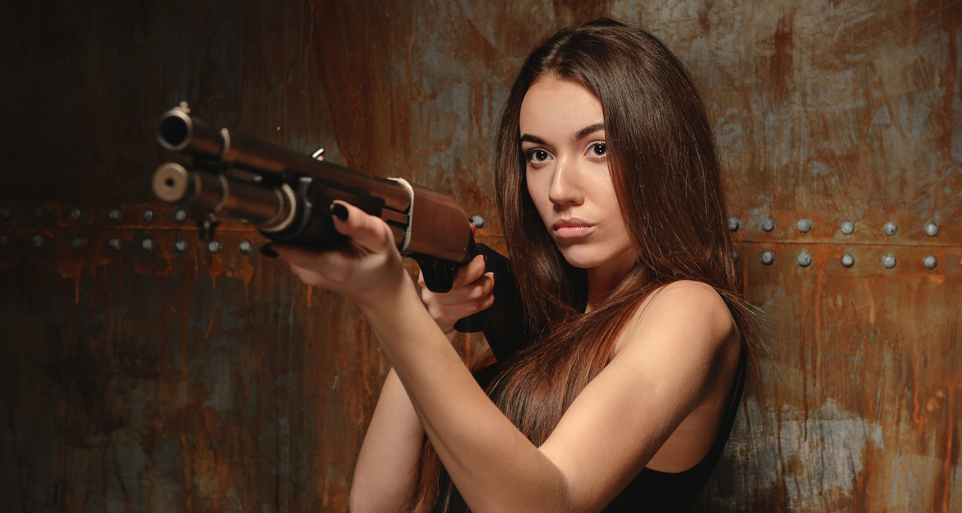 woman holding shotgun